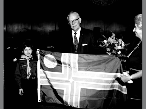 1974 city archives Terry Schrunk with city flag (Photo Portland City Archives)