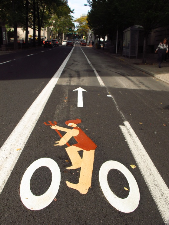 The new Portlandia bike lane stencil was installed on 10/6/2015 in tribute to Portlandia on her 30th birthday. The stencil is right next to City Hall on SW Jefferson at 4th.