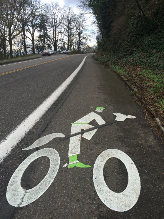 Bike lane stencil SW Terwilliger Blvd and Campus Drive.
