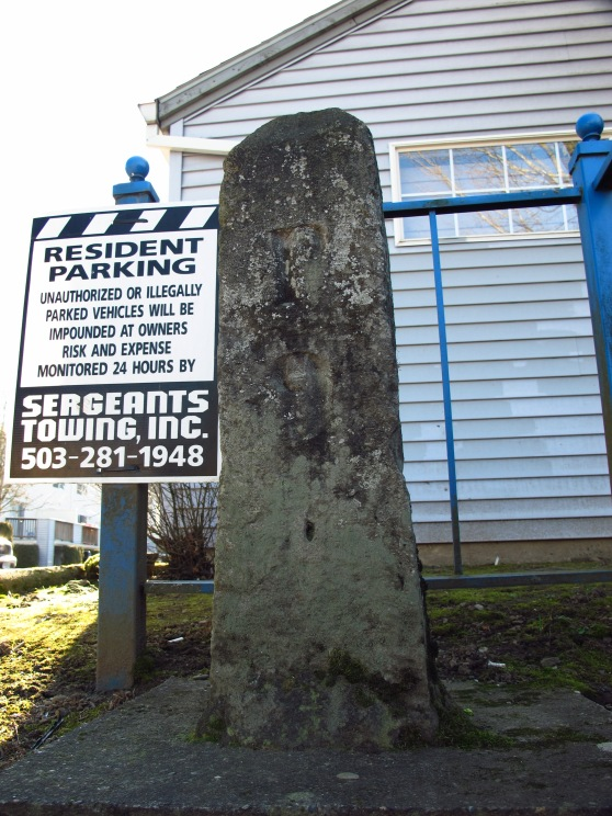 Stark Street Markers (Milestones) P9 sad state for this one, it's just sitting next to some apartment buildings with a towing sign to keep it company at around 158th.