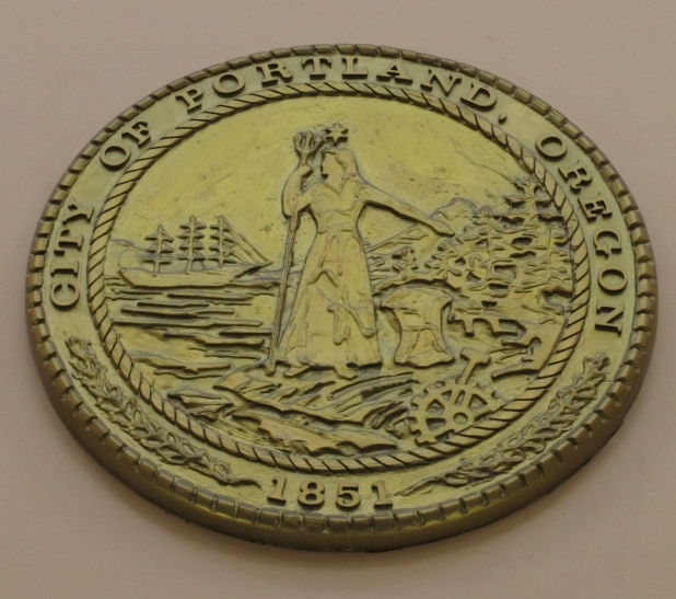"The City Seal featuring Lady Commerce who image of Portlandia was based on. Look up as you enter the Portland building to see the City Seal that the image of ""Portlandia"" was based on."