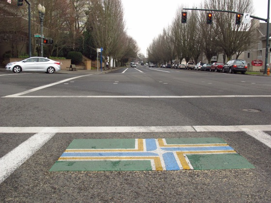 One of eight Portland Flags decorating the bike buffer lane on Multnomah St by Lloyd Center.