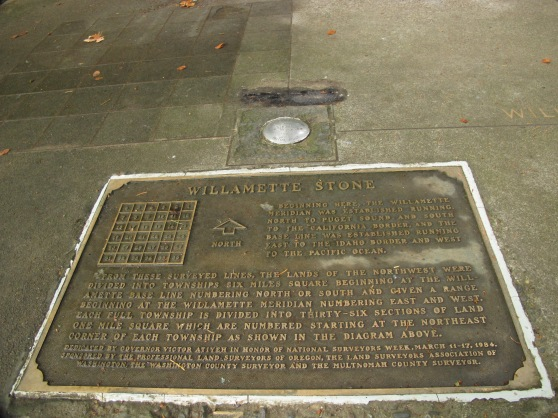 What's left of the Willamette Stone is now planed down flush with after being vandalized over the years. This is the second plaque, the last was pried from the ground and stolen.
