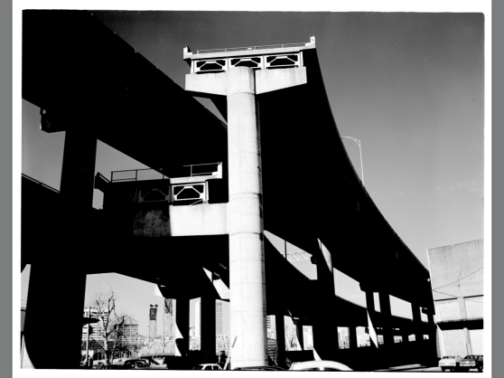 The lover ramp-to-nowhere remains the same today located in the north OMSI parking lot.  The upper ramp was meant to connect to the Mt. Hood Freeway and travel up Division St.  THat lane ended up being repurposed when the widenedthat section of the Marquam Bridge.