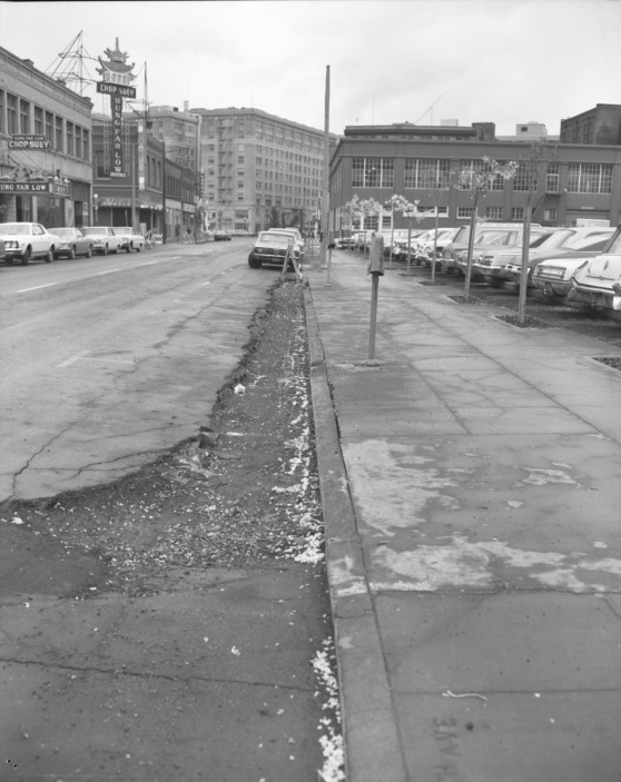 View of curb on NW 4th from NW Davis 1969 and Hung Far Low Sign