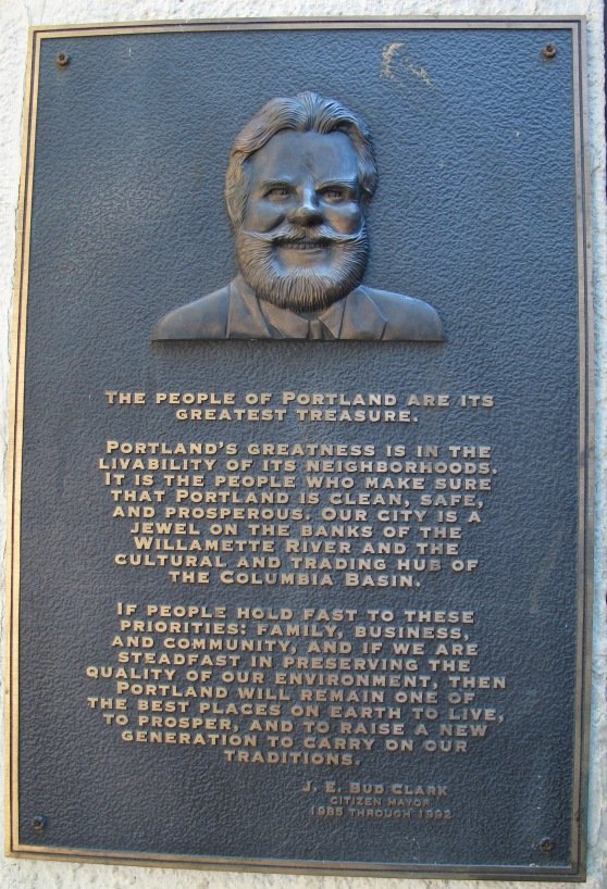 Brass Plaque honoring Bud Clark. The plaque is located under the Burnside Bridge at the Skidmore Light-rail station on 1st st.