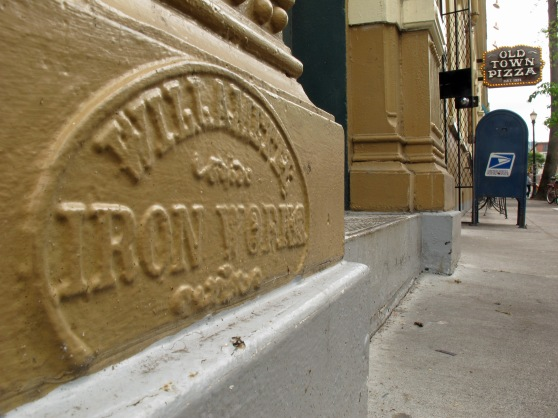 Iron facade of the Merchants Hotel with Willamette Iron Works plaque