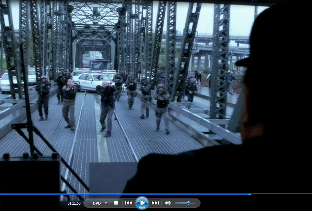 1.11.56 The long trip across the bridge comes to an end