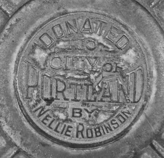 The Nellie Robinson Bubbler has this plaque in the center of the four arms where the Benson has a smooth top (or a nipple top).