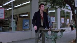 Bob (Matt Dillon) drinking from bubbler